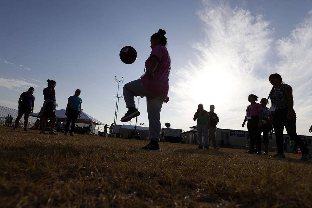 File - In this July 9, 2019, file photo, immigrants play soccer at the U.S. government's newest ...