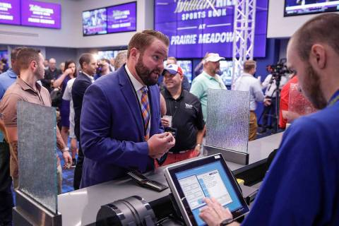 Jake Highfill, a former member of the Iowa House of Representatives, places a bet at Prairie Me ...