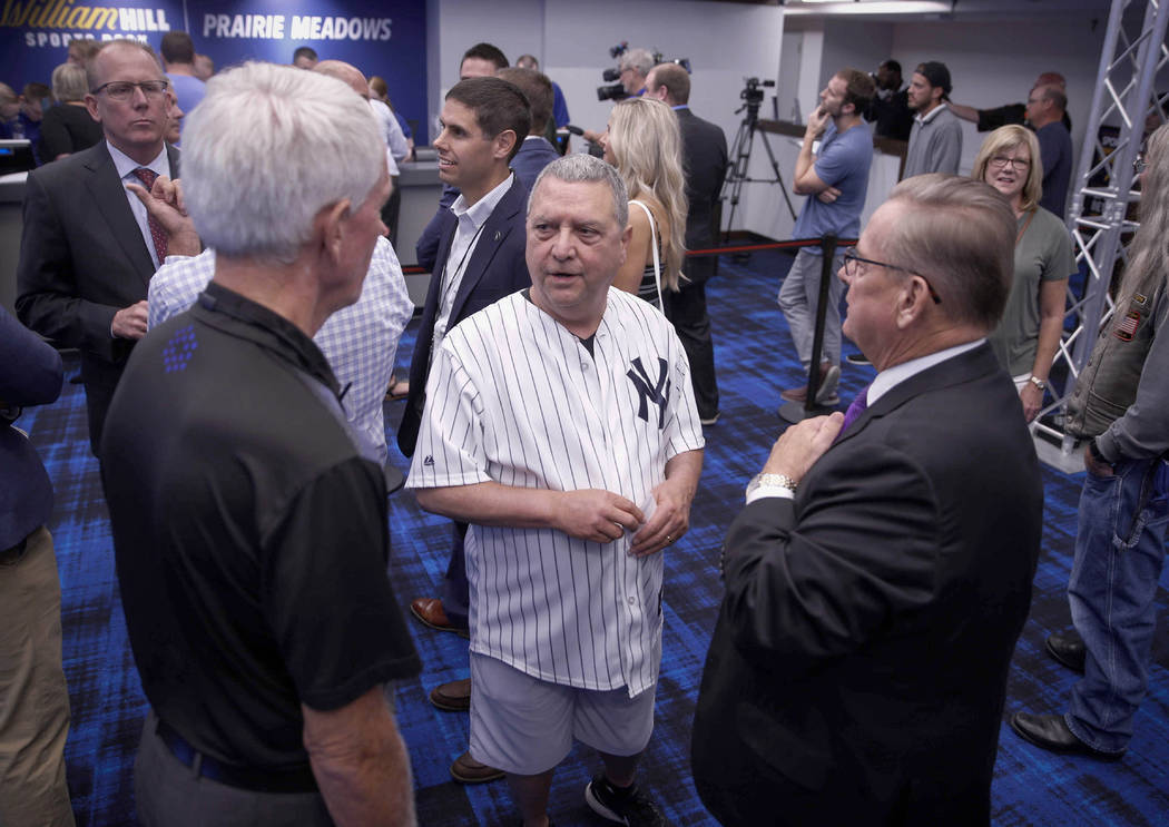 State senator Tony Bisagnano (D-Des Moines) donned a New York Yankees jersey to place the inaug ...