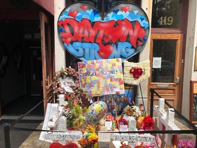 A makeshift memorial sits outside Ned Peppers nightclub in the Oregon District entertainment ne ...