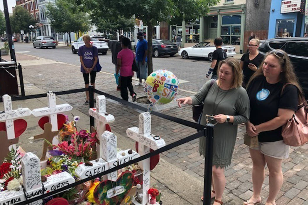 Sabrina Herman, gesturing, visits a makeshift memorial on Wednesday, Aug. 14, 2019, outside Ne ...