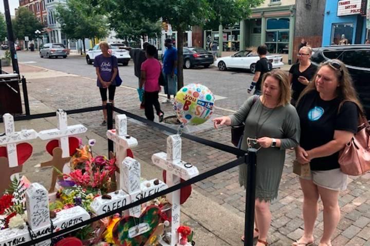 Sabrina Herman, gesturing, visits a makeshift memorial on Wednesday, Aug. 14, 2019, outside Ne ...
