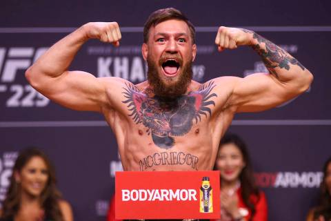 Conor McGregor weighs in ahead of his fight against Khabib Nurmagomedov during the ceremonial w ...