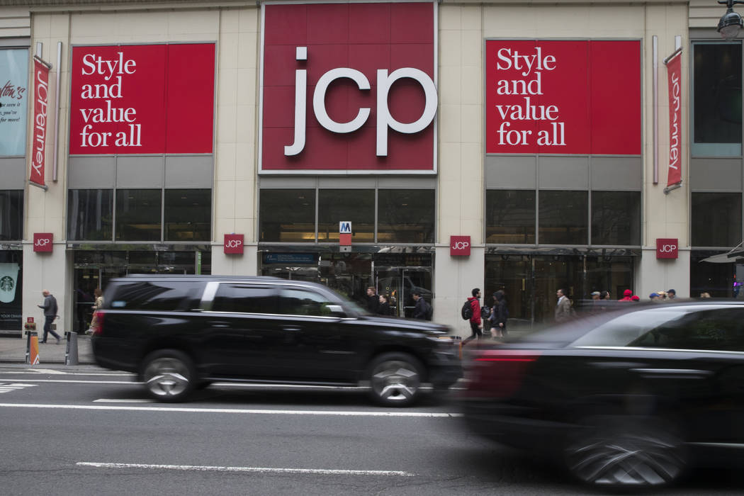 FILE - In this May 16, 2018, file photo, traffic makes its way past a logo J.C. Penney store ou ...