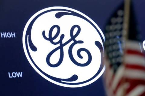 FILE - In this June 26, 2018, file photo the General Electric logo appears above a trading post ...