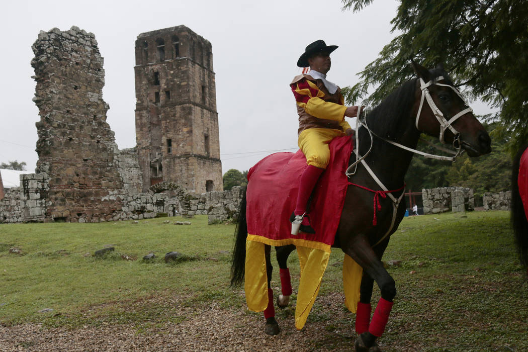 A man dressed as old colonial Spaniard rides a horse during the activities celebrating the 500 ...