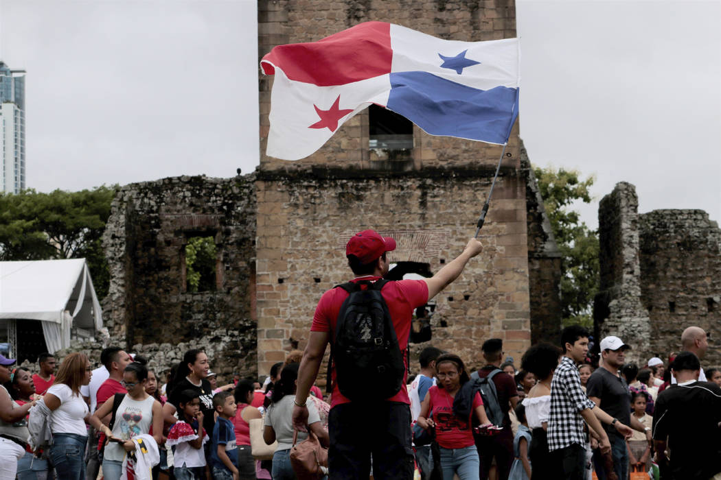 A person waves a Panama flag during the activities celebrating the 500 anniversary of the found ...