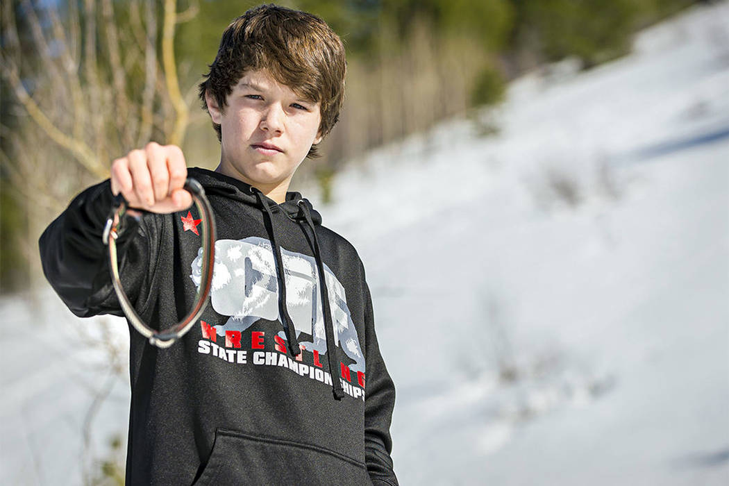 Canyon Mansfield, 14, holds the collar of his dog, Casey, on March 17, 2017. The dog was killed ...