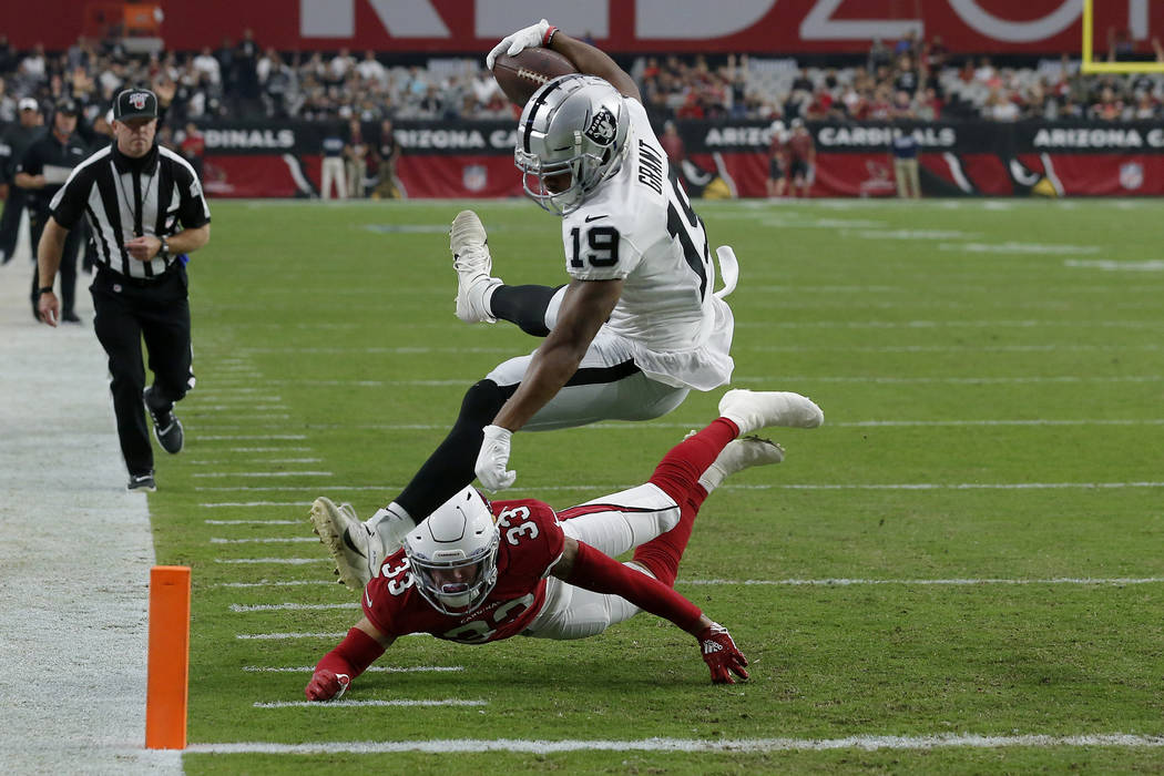 Oakland Raiders wide receiver Ryan Grant (19) scores a touchdown as Arizona Cardinals cornerbac ...