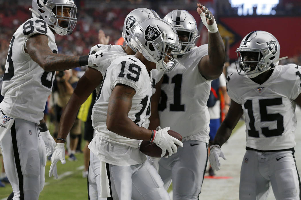 Oakland Raiders wide receiver Ryan Grant (19) celebrates his touchdown against the Arizona Card ...