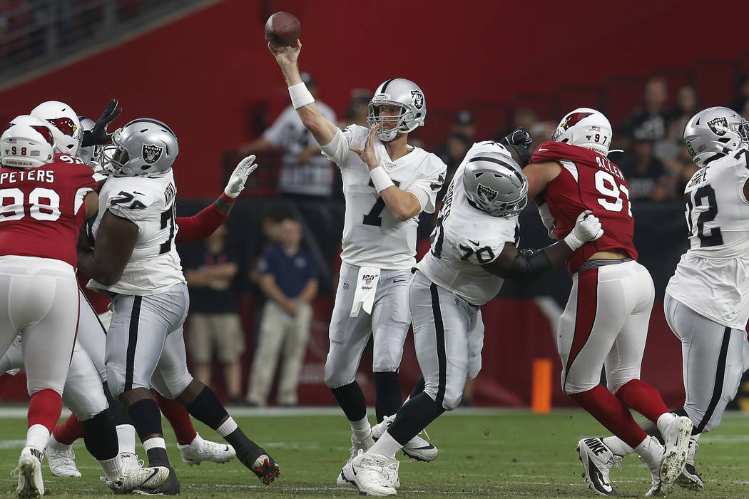 Oakland Raiders quarterback Mike Glennon (7) throws against the Arizona Cardinals during the fi ...