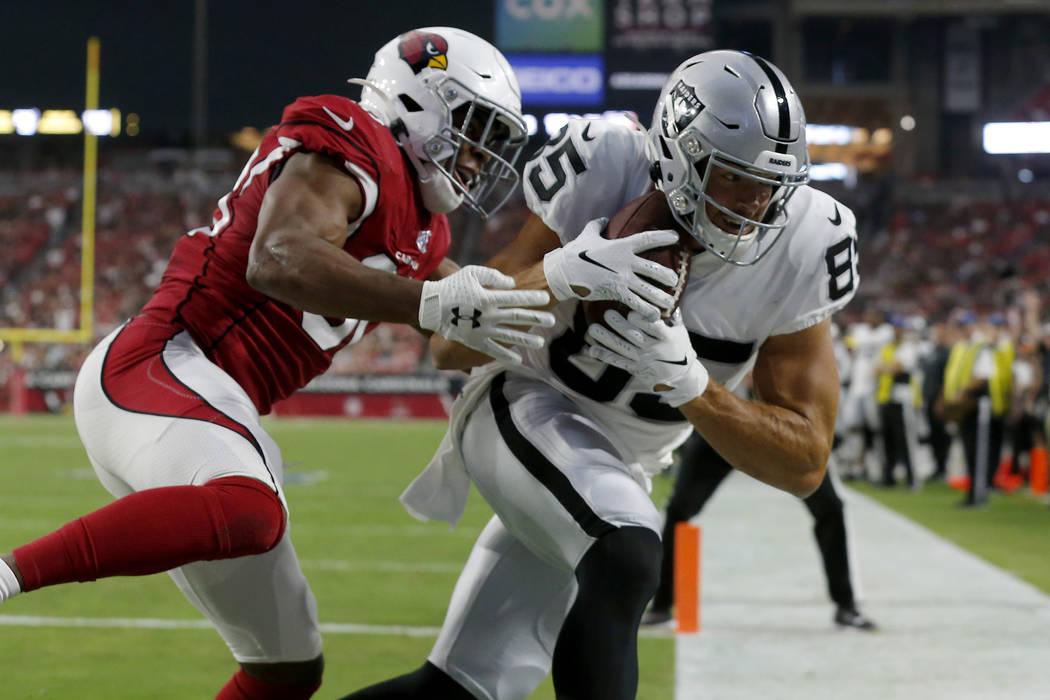 Oakland Raiders tight end Derek Carrier (85) scores a touchdown as Arizona Cardinals defensive ...