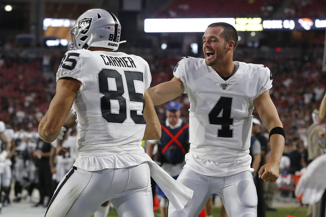 Oakland Raiders tight end Derek Carrier (85) celebrates his touchdown against the Arizona Cardi ...