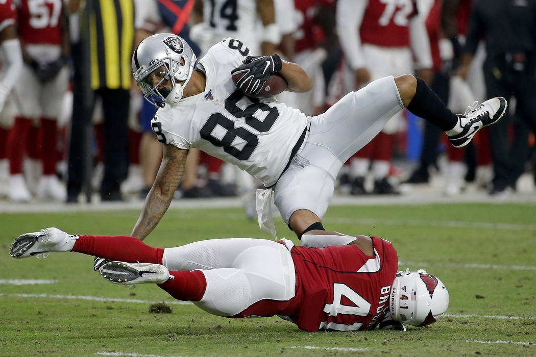 Oakland Raiders wide receiver Marcell Ateman (88) is hit by Arizona Cardinals defensive back Na ...