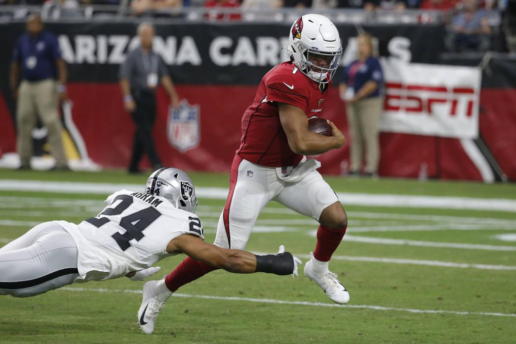 Arizona Cardinals quarterback Kyler Murray (1) scrambles as Oakland Raiders defensive back John ...