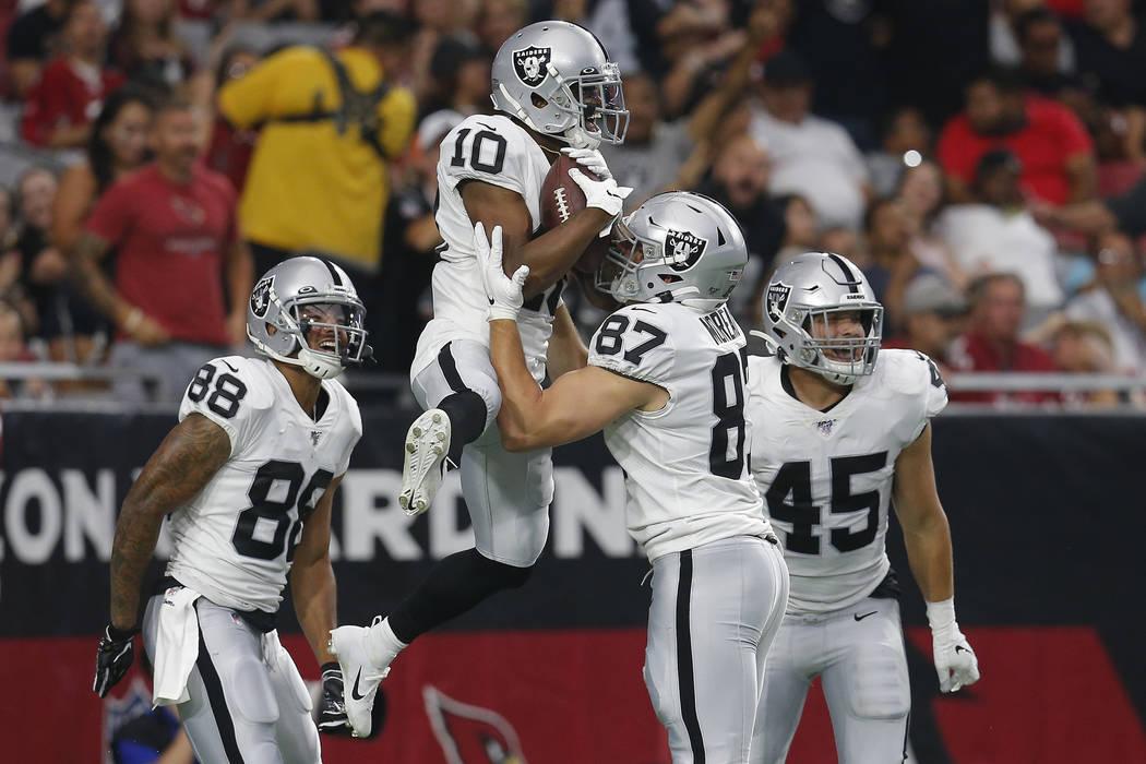 Oakland Raiders wide receiver Rico Gafford (10) celebrates his touchdown against the Arizona Ca ...