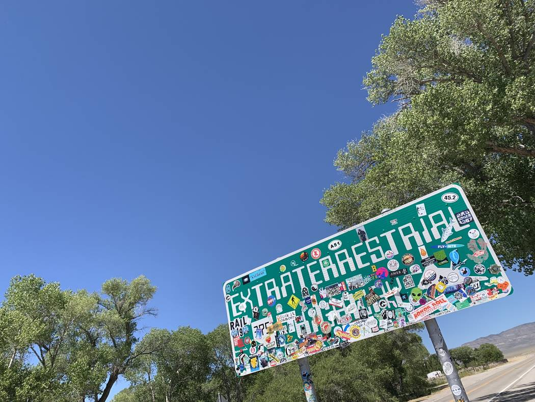The Extraterrestrial Highway sign, covered with stickers, is seen along State Route 375 on July ...
