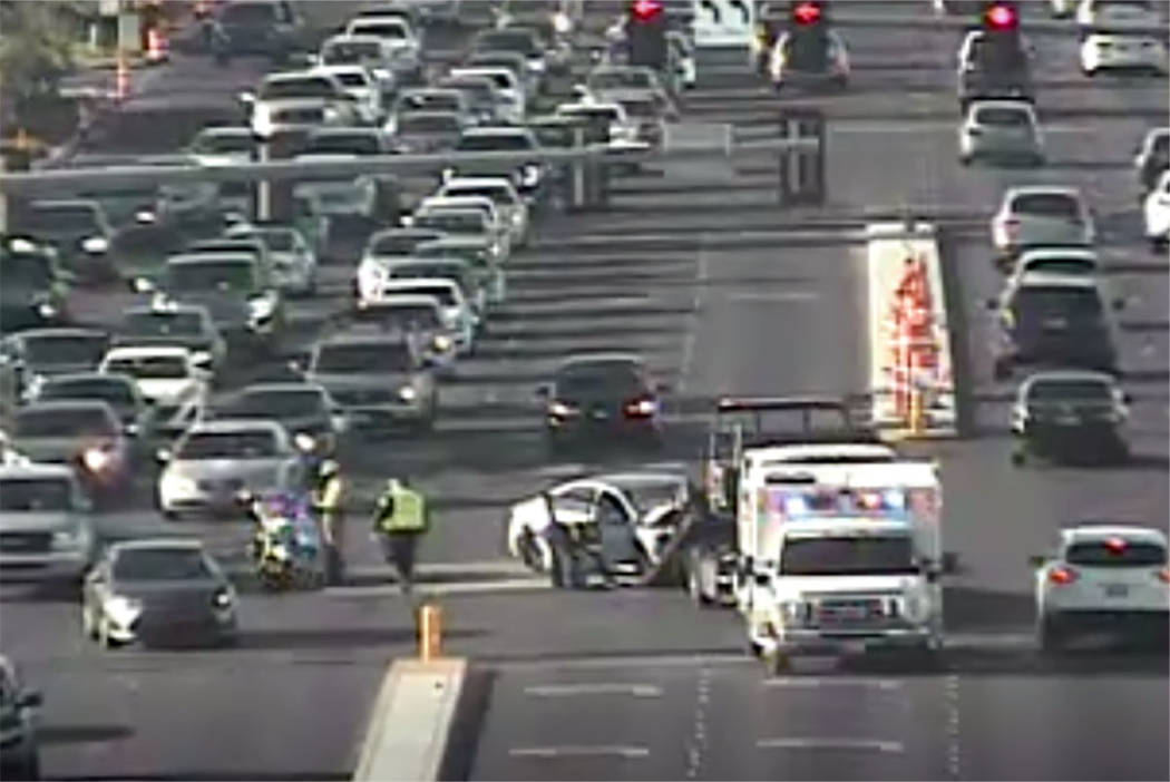 Las Vegas police respond to a crash at South Rainbow Boulevard and West Post Road on Thursday, ...