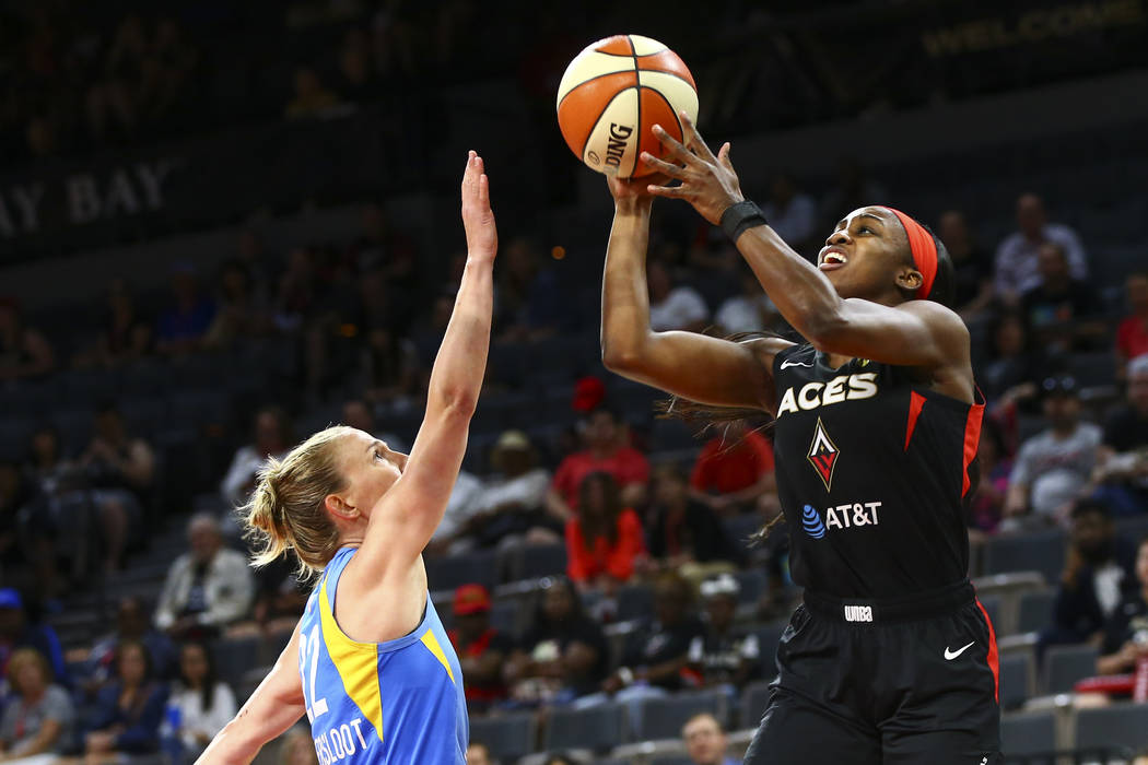 Las Vegas Aces' Jackie Young, right, shoots over Chicago Sky's Courtney Vandersloot (22) during ...