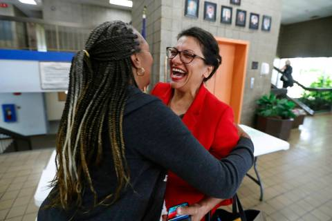 U.S. Rep. Rashida Tlaib, D-Mich., greets a constituent in Wixom, Mich., Thursday, Aug. 15, 2019 ...
