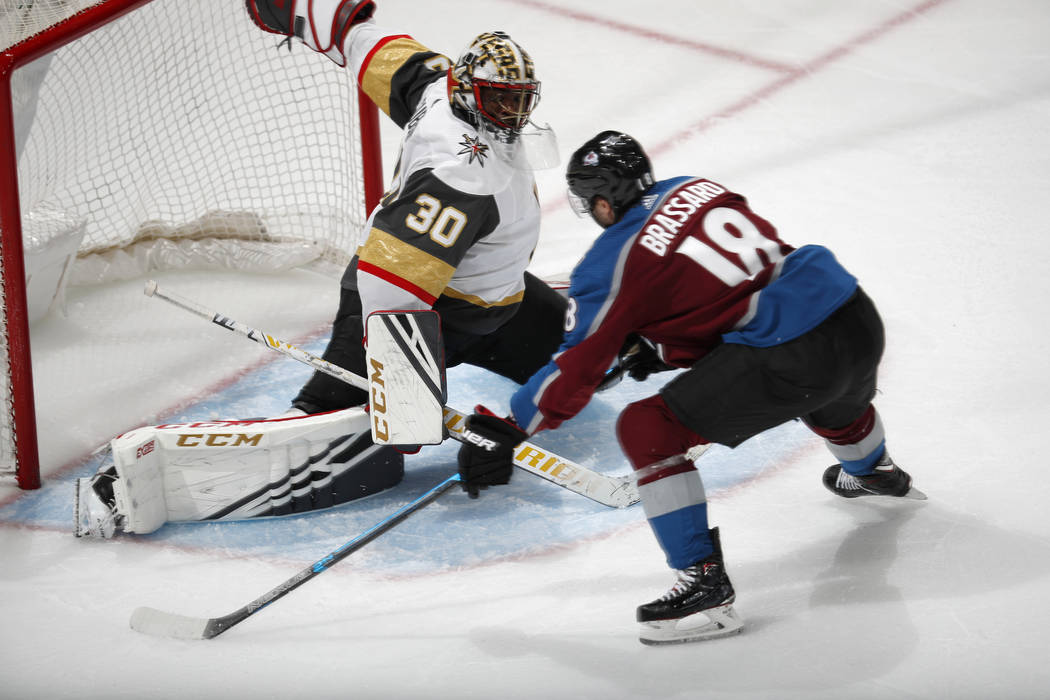 Vegas Golden Knights goaltender Malcolm Subban, left, makes a save against Colorado Avalanche c ...