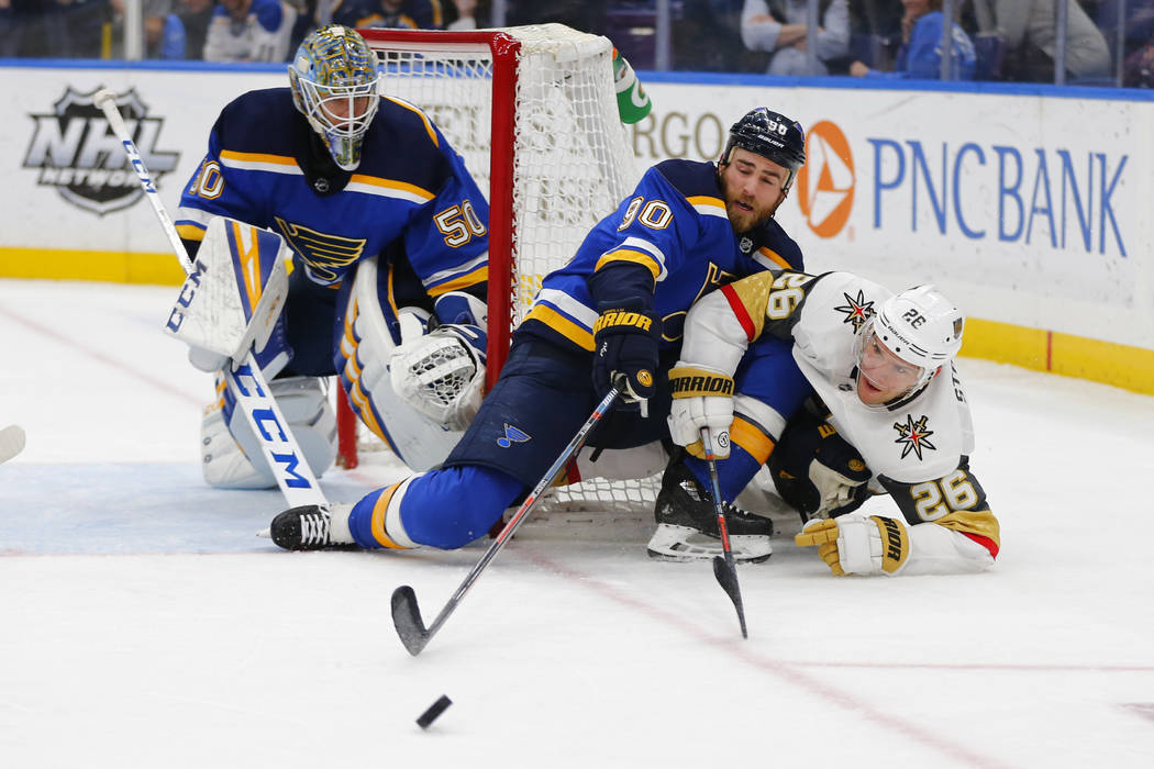 St. Louis Blues' goalie Jordan Binnington (50) and Ryan O'Reilly (90) defend the goal against V ...