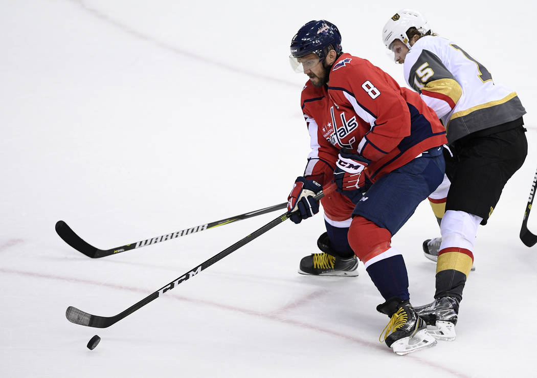 Washington Capitals left wing Alex Ovechkin (8), of Russia, skates with the puck against Vegas ...