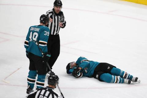 Sharks center Joe Pavelski (8) lays on the ice after getting hit by Knights center Cody Eakin ( ...