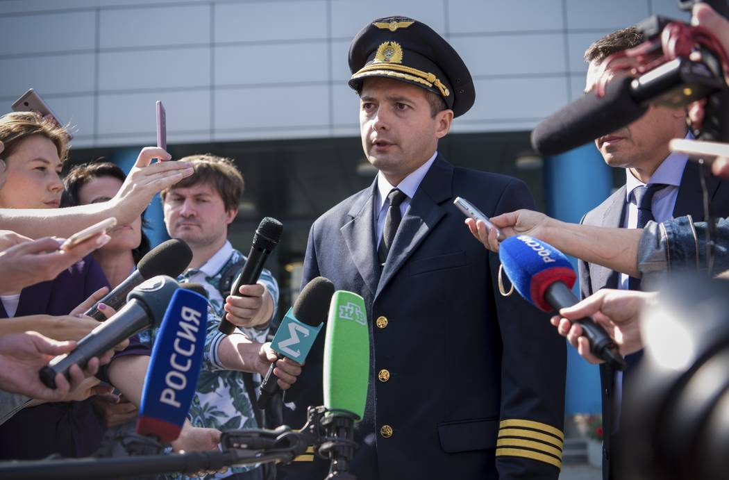 Damir Yusupov, 41-year-old Russian pilot, speaks to the media in Yekaterinburg, Russia, Friday, ...