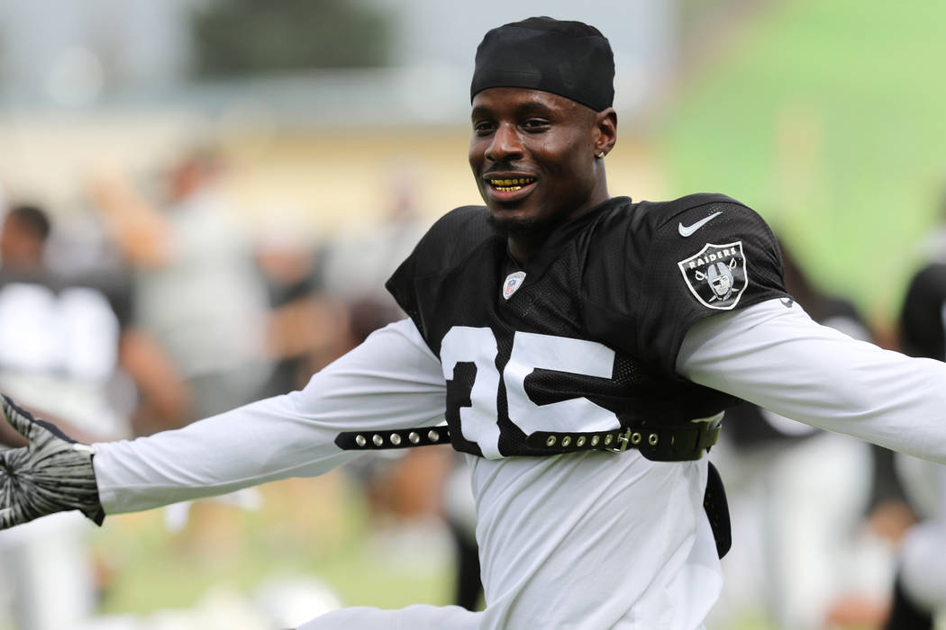 Oakland Raiders free safety Curtis Riley (35) stretches during the NFL team's training camp in ...