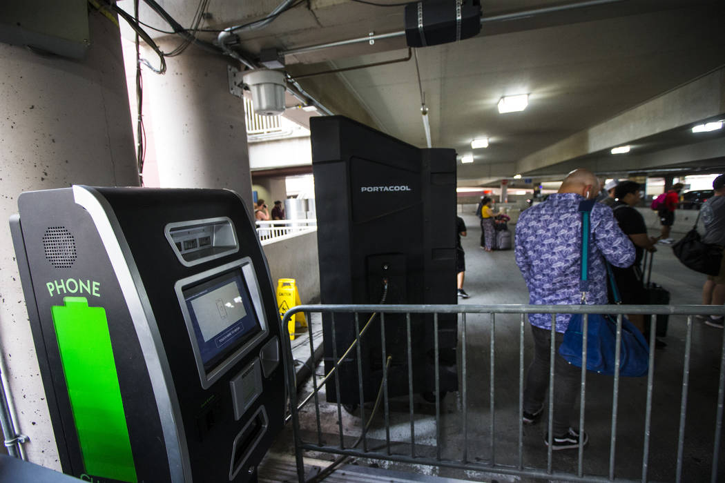A vending machine offering portable batteries in the rideshare area at Terminal 1 at McCarran I ...