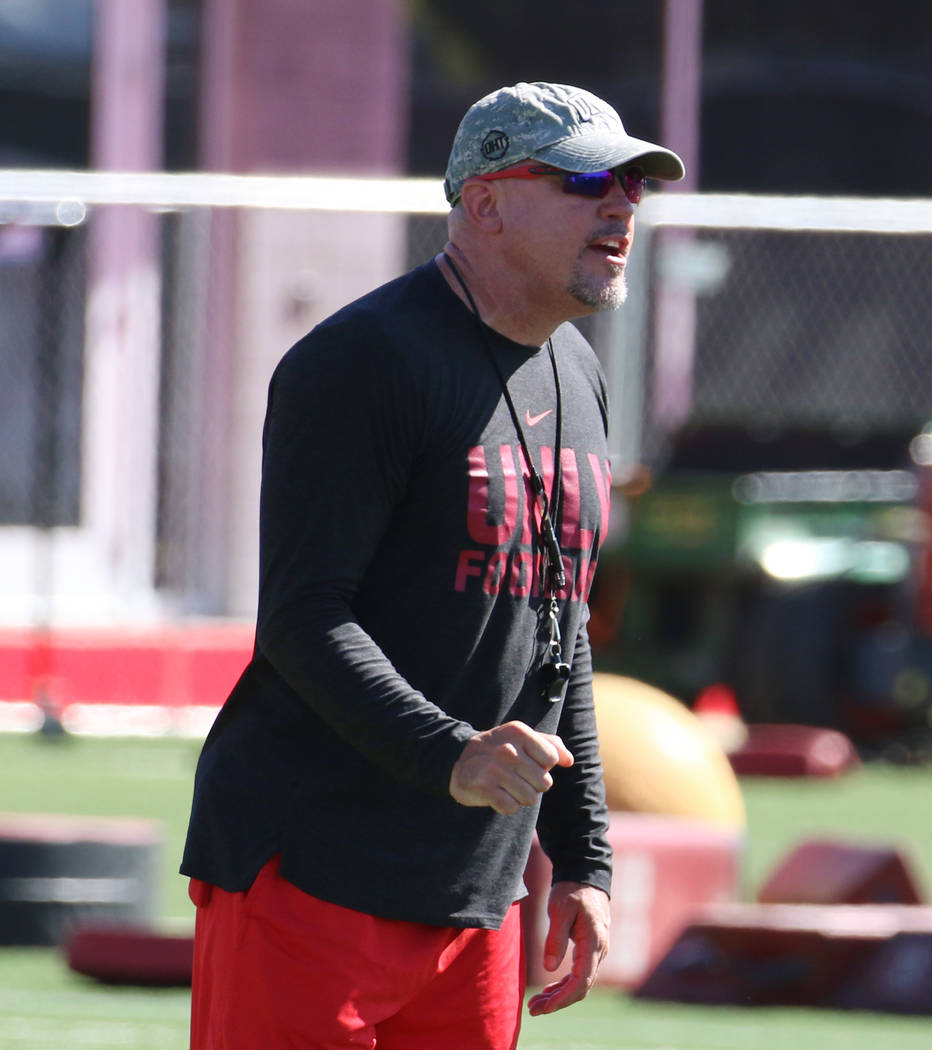 UNLV Rebels head coach Tony Sanchez instructs his players during team practice on Tuesday, Aug. ...