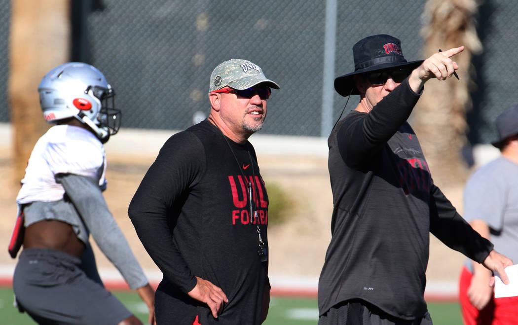 UNLV Rebels head coach Tony Sanchez, center, and quarterbacks coach Ron O'Dell, second right, w ...