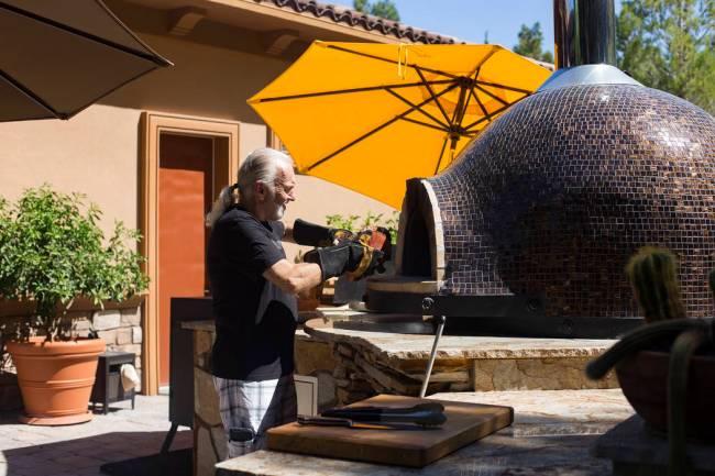 Hubert Keller, chef of Fleur de Lys and Fleur, prepares his Forno Piombo wood burning oven in h ...