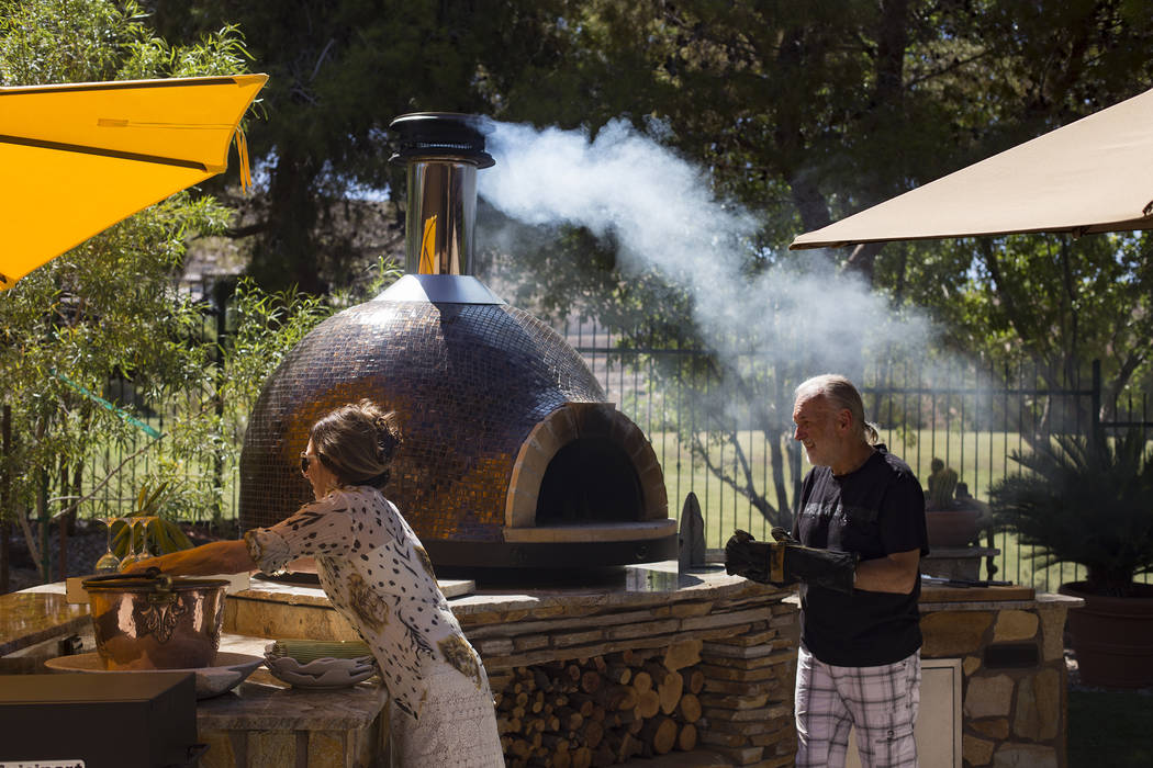Hubert Keller, chef of Fleur de Lys and Fleur, prepares his Forno Piombo wood burning oven next ...