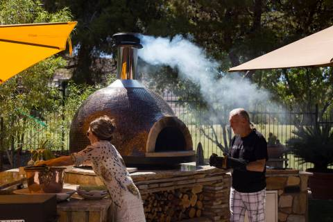 Hubert Keller, chef of Fleur de Lys and Fleur, prepares his Forno Piombo wood burning oven next ...