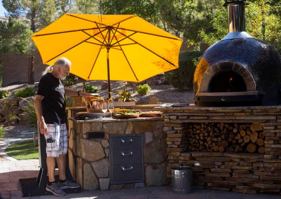 Hubert Keller, chef of Fleur de Lys and Fleur, pours rosŽ n his backyard kitchen in Las V ...