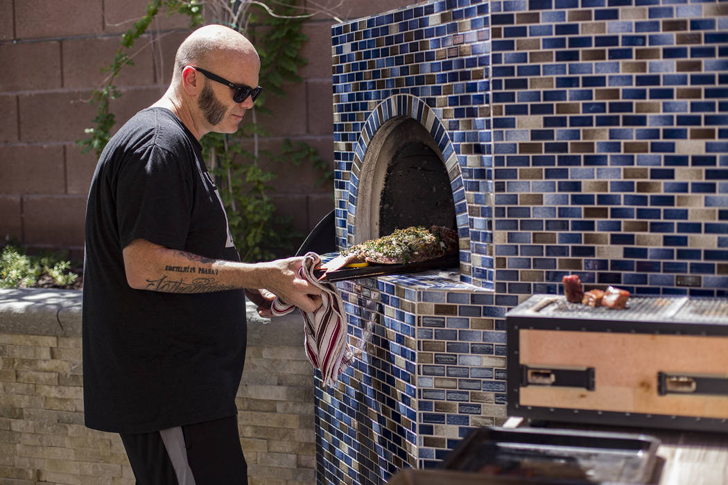 John Courtney, chef of Block 16 at The Cosmopolitan of Las Vegas hotel-casino, pulls out a red ...