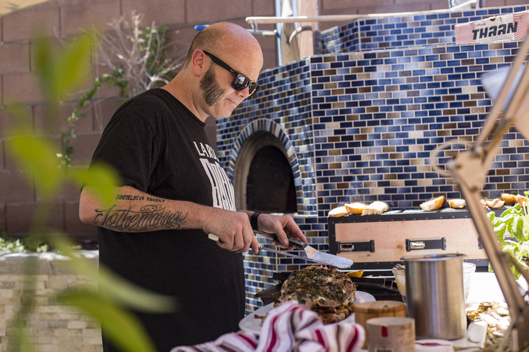 John Courtney, chef of Block 16 at The Cosmopolitan of Las Vegas hotel-casino, cooks lunch in h ...