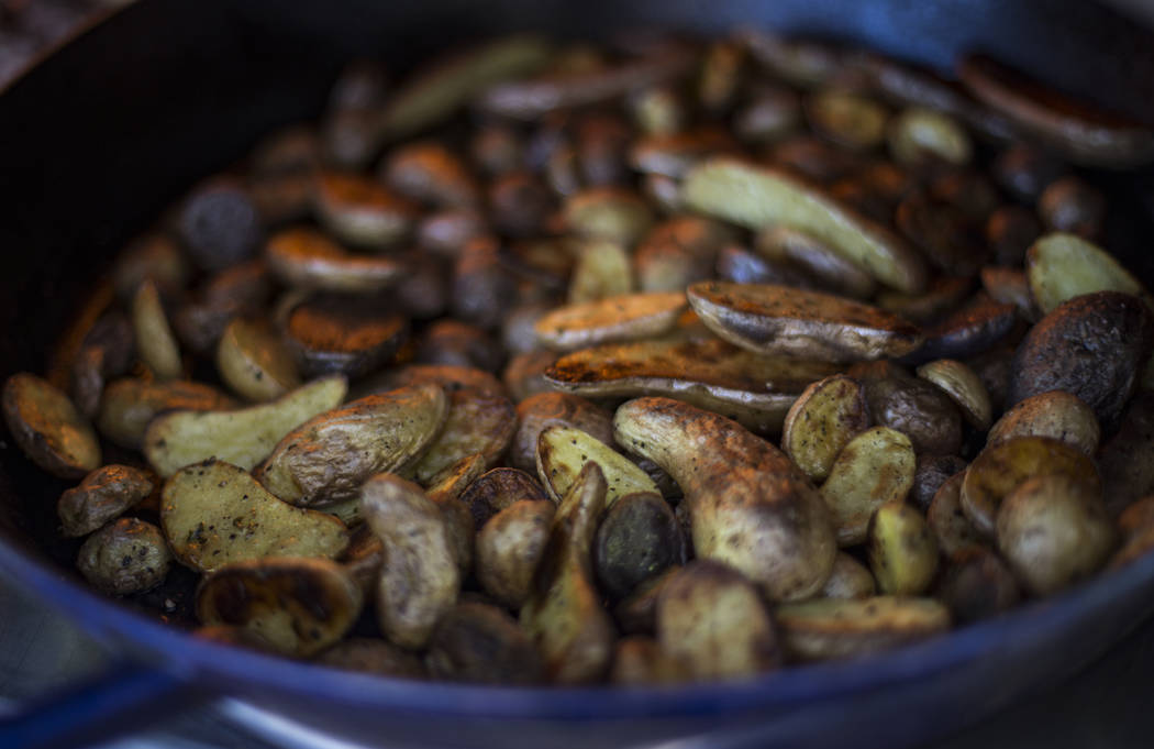 Roasted potatoes n the backyard kitchen of Matt Silverman, chef for HEXX Kitchen + Bar, in Las ...