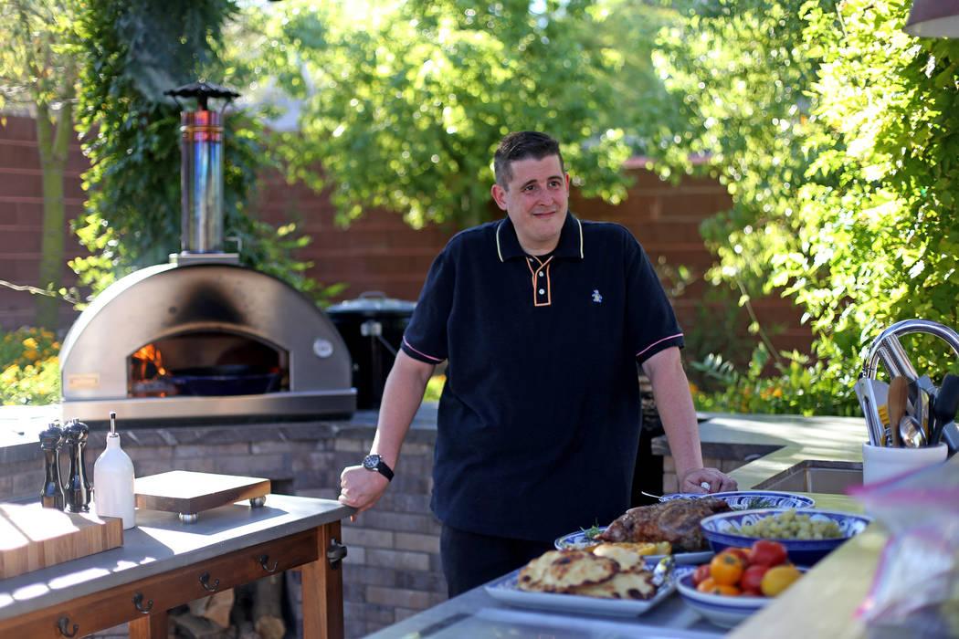 Matt Silverman, chef for HEXX Kitchen + Bar, in his backyard kitchen in Las Vegas, Wednesday, A ...