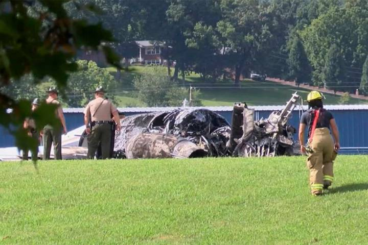 The burned remains of a plane that was carrying NASCAR television analyst and former driver Dal ...
