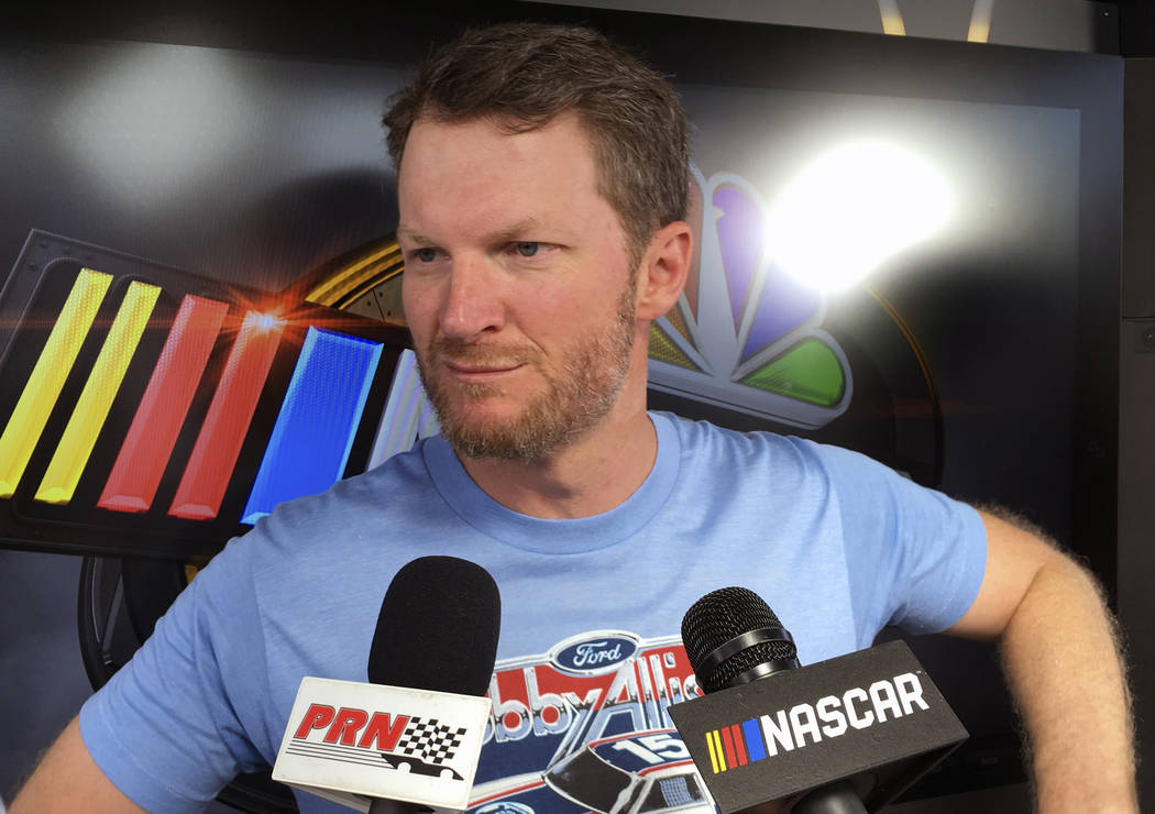 Dale Earnhardt Jr. goes through an interview during NASCAR auto racing pre-race activities at D ...