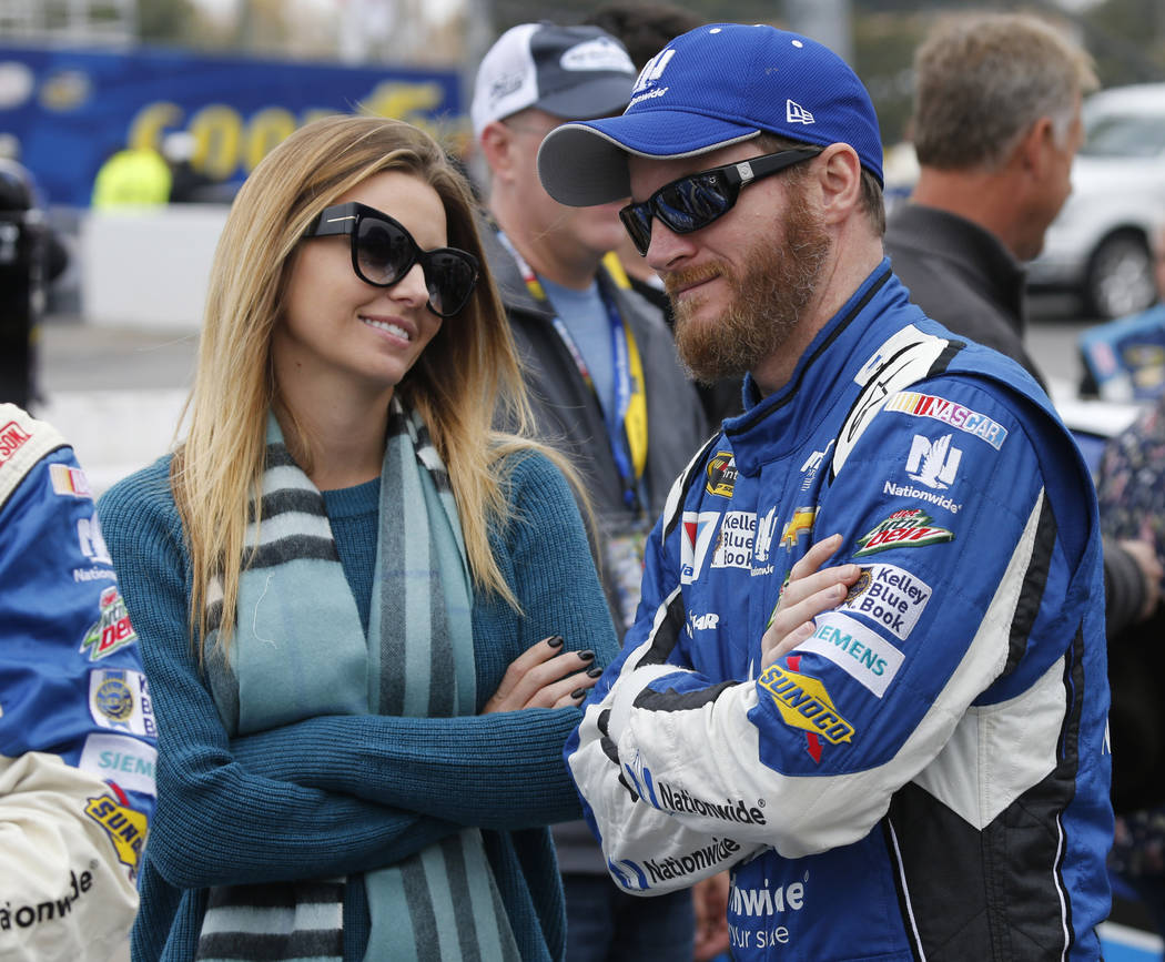 Sprint Cup Series driver Dale Earnhardt Jr. talks with his then-fiance, Amy Reimann, prior to ...