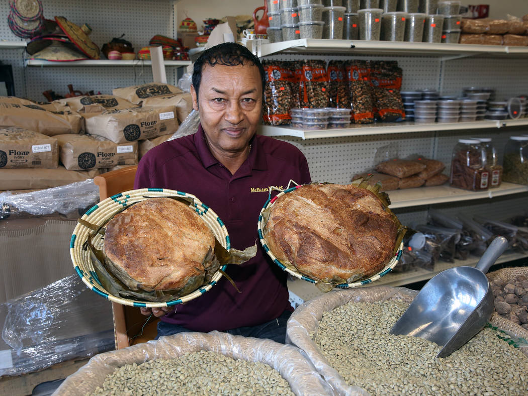 Legesse Tigabu, owner of Melkam Market, an Ethiopian store, poses for photo, holding home made ...