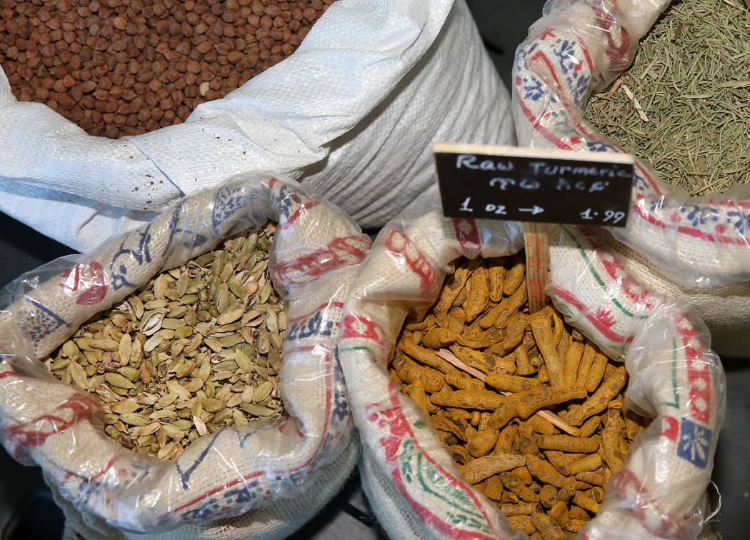 Ethiopian spices, including raw turmeric, front right, are displayed at Melkam Market, an Ethio ...