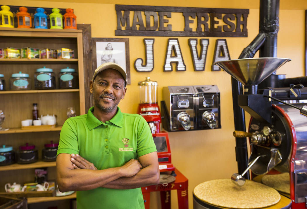 Solomon Teklu, owner of Java Tree, poses for a portrait his store at Flamingo Road and Decatur ...