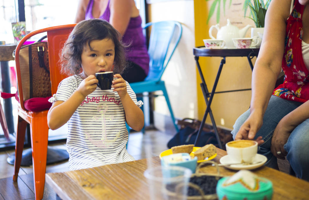 Lyla, 4, of Las Vegas, enjoys a drink at Java Tree at Flamingo Road and Decatur Boulevard in La ...