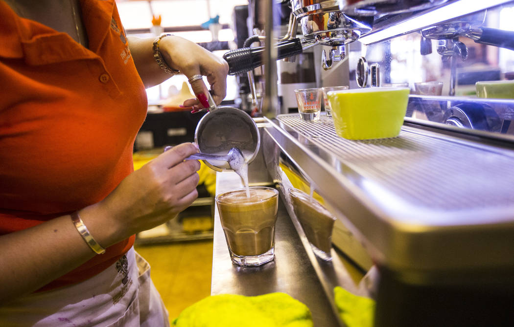 Gio Marongiu, store manager at Java Tree, prepares coffee at the store at Flamingo Road and Dec ...