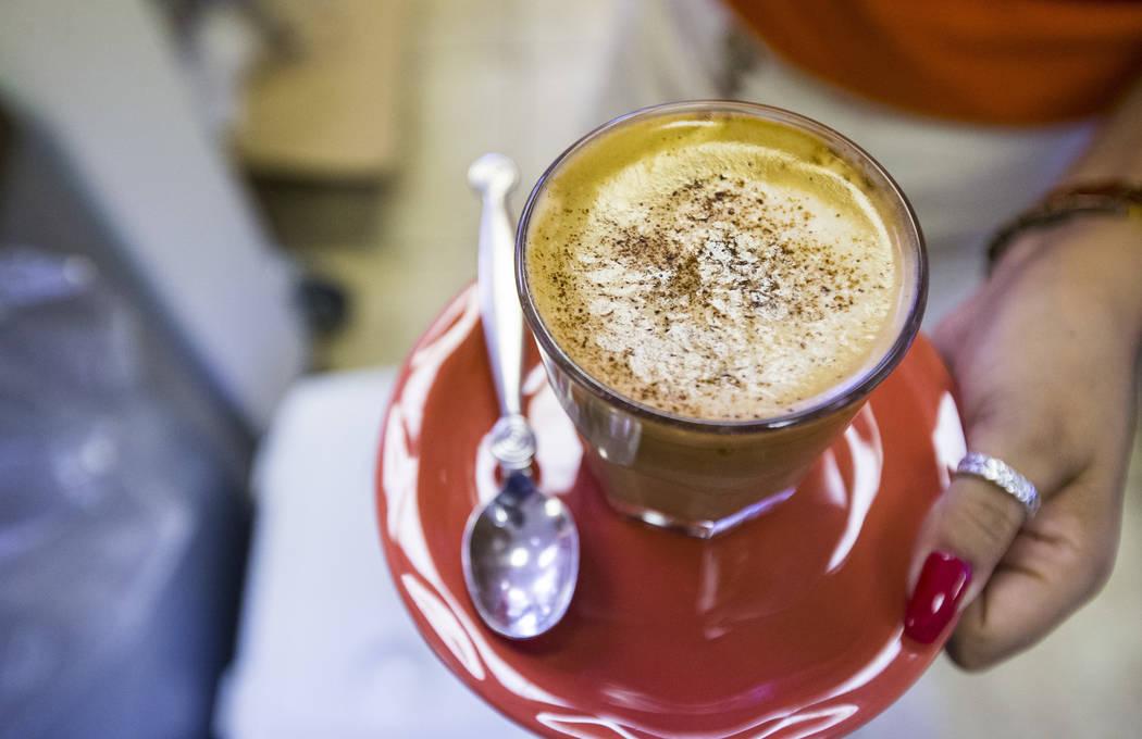 Gio Marongiu, store manager at Java Tree, prepares to serve coffee at the store at Flamingo Roa ...